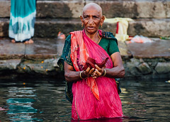 Pierced Pilgrim Woman in Ganges, Varanasi India (AdamCohn) Tags: adam cohn adamcohn ganga ganges gangesriver india uttarpradesh varanasi bodymodification dawn ghats morning pierced pilgrims pooja prayer puja sari streetphotographer streetphotography sunrise wwwadamcohncom