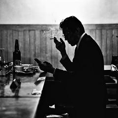 salary man (gro57074@bigpond.net.au) Tags: salaryman smoking grain f28 contrast silhouette 2470mmf28 tamron d850 nikon 2019 february izakaya man guyclift monotone mono blackwhite bw sapporo japan hokkaido susukino
