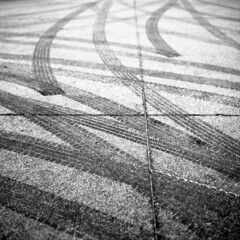 untitled (kaumpphoto) Tags: rolleiflex 120 tlr ilford bw black white tire tracks snow lines intersect marks compress arch bend curve bowed street urban city imprint abstract minneapolis