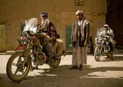 Men Posing On Their Motocycle,  Amran, Yemen (Eric Lafforgue) Tags: amran arabia arabiafelix arabianpeninsula biker blue bluesky colourpicture community dailylife day door fulllength horizontal irondoor lookingatcamera man placeofinterest realpeople relax sable sand smile smiling street sun three threemen threepeople turban yemen yemeni a0701333 houthis