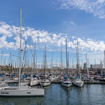 Sailboats at harbour Port Vell, next to promenade Rambla de Mar in Catalonia, Barcelona (Spain) thumbnail