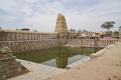 Rocks and Time (brantliveson) Tags: ruins landscape temple ancient hampi india karnataka reflection pool green water blue sky tower old building architecture travel sony zeiss