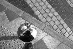 Auto-plortrait (Tonton Gilles) Tags: alençon normandie place du champ perrier rue de labreuvoir noir et blanc passage piéton reflets autoportrait plot rond cercle pavés graphisme nuages
