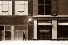 Late night winter walk (HisPhotographs.com) Tags: snow toronto winter cold lonely person walking downtown city urban 6ix store stores shop shops yonge yongestreet light night lamp snowing snowfall