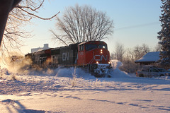 Wave Rider (view2share) Tags: cn5791 sd75i emd electromotivedivision engine cn canadiannational cold snow snowfall snowcover minneapolissub newrichmond wisconsin wi winter morning sun sunrise sunny stcroixcounty westernwisconsin railway railroading railroads rail rails railroaders rr rring railroad trains track transportation train tracks transport trackage trees travel trackmaintenance deansauvola siding sidetrack march22019 march2019 march 2019 517 l517 cn517 cnl517