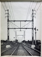 Combined two track structure 1500 Volt traction and 20,000 Volt Transmission lines, Reservoir line. (Public Record Office Victoria) Tags: railways train electrification blackandwhite archives victoria reservoir 1919