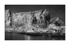 The Moonlit Wall Of Sakrisoy (W.Utsch) Tags: landscape lofoten bnw mountain rocks village night snow winter ice water norway