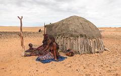 Himba Women and Child (Trouvaille Blue) Tags: africa namibia kaokoland kunene himba tribe village woem child dunghut ochre trouvailleblue