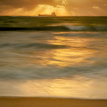 Sunrise with cargo ship and waves on Fort Lauderdale Beach, Fort Lauderdale, Florida thumbnail