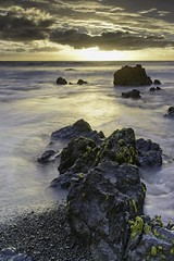 At the end of the day (dave.fergy) Tags: coast beach rocks sunset summer lowcontrast leadinglines