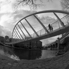 Footbridge (4foot2) Tags: castlefield manchester footbridge people peoplewatching interestingpeople manchesterpeople walking walk bridgewatercanal canal water analogue film filmphotography 120film mediumformat bw blackandwhite monochrome mono kiev kiev88cm 88cm киев88cm ukrainiancamera fisheyelens fisheye zodiak8b3530fisheyelens zodiak8b3530 zodiak8b 3530 зодиак8б ussr fsu formersovietunion tmax kodaktmax tmax100 kodaktmax100 kodak hc110 kodakhc110 2019 fourfoottwo 4foot2 4foot2flickr 4foot2photostream