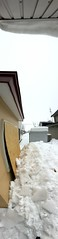 Snow and Ice on the Ground 6 (sjrankin) Tags: 20february2019 edited snow weather winter snowbank kitahiroshima hokkaido japan panorama neighborhood houses