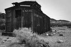 Caboose (NormFox) Tags: america bw bnw badlands blackandwhite blackandwhiteartistry caboose contrast deathvalley desert dry ghosttown land landscape miningrhyolite monochrome mood mountains nevada old outdoors park photography quite remote rocks senic serene sky tone train usa valley abandoned hike stones beatty unitedstatesofamerica us