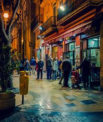 Nightlife - Valencia Style (La Boatella Tapas Bar - Valencia) (Cross Process Effect) (Olympus OM-D EM5-II & M.Zuiko 17mm f1.2 Pro Prime) (1 of 1) (markdbaynham) Tags: valencia valencian valenciacanibal spainish street city cityscape citybreak citylife evil espana espanol vlc europeancity urban urbanlife metropolis olympus omd olympusmft olympusomd olympusspain olympusm43 olympusespana em5markii em5 em5ii em52 csc mirrorless microfourthird microfourthirds m43 micro43 m43rd micro43rd olympusem5 crossprocess laboatella tapas nightlife nightscene people candid 17mm prime primelens mzd mzuiko zuikolic zd olympistas spanish fixedlens