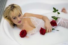 Milk bath with roses (piotr_szymanek) Tags: ania aniaz woman young skinny portrait studio face transparent lingerie milk bath milkbath bathroom bathtube rose flower smile eyesoncamera feet boobs tits blonde 1k 20f 5k 50f 10k 20k 30k 40k