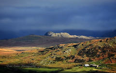 What lies beyond: Green Crag with the Scafells lost under cloud. (trev.eales) Tags: greencrag birkerfell corneyfell fells scafellpike scafell moorland farmhouse clouds sunlight mountains lakedistrict cumbria isolated nikon treveales