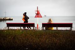 Sea view in red ... (Klaus Wessel) Tags: olympus omd mft street streetlife helgoland nordsee meer ufer insel küste schiff wasser red jogger bank bänke 1240mm menschen rot