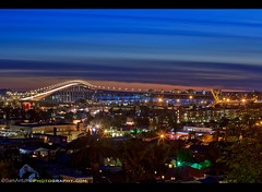 Coronado Bay Bridge shines brightly as an iconic San Diego Landmark (Sam Antonio Photography) Tags: granthillpark barriologan crossing baybridge night bridge water architecture coronado city cityscape landmark urban evening san travel california sea bay usa skyline lights downtown sunset tourism sandiego pacific harbor sandiegobay coronadobridge buildings waterfront romantic southerncalifornia traveldestination sandiegocalifornia nightcity