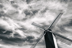 Windmill (Rayoflightbe) Tags: brugge windmill cloudscape clouds black white monochrome heritage city sky
