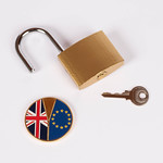 Brexit medal coin with open padlock and key on white background thumbnail