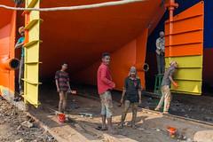 Ship Painting (Jeff Williams 03) Tags: dhaka bangladesh buriganga ship yard boat workers painting colour portrait street photography candid orange yellow