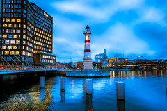 Cityscape in blue hour (Maria Eklind) Tags: universitetsbron fyr inrehamnen lighthouse studiomalmö malmö dockan architecture reflection spegling sweden cityscape water city twilight bluehour skånelän sverige se