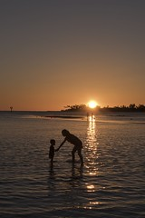 Mother and Child (Fletch in HI) Tags: nikon d5600 tamron 16300 sunset hickamafb pearlharbor honolulu hawaii sky clouds water ocean oahu people