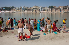 On the sandbank from the Ganges river (Dick Verton ( more than 13.000.000 visitors )) Tags: india asia varanasi bathing river ganges otherside people view traveling washing