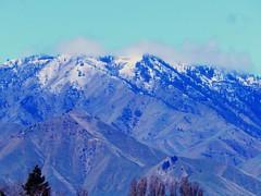 Saddle Rock Mountain (starmist1) Tags: snow snowcapped peak saddlerock mountain columbiariver wenatchee northwest trees grasses conifers spring april rain warm clouds sky