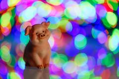 MM: Redux 2018 (Holiday Bokeh) (donnicky) Tags: holidaybokeh macromondays newyear redux2018 artificialillumination blurredbackground bokeh closeup colorful dof holding light macro nopeople pig publicsec selectivefocus symbolism toy