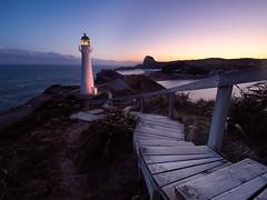 Castle Point Lighthouse (v-_-v) Tags: sunset ocean newzealand castlepoint lighthouse rocks wind weather sky glow stair leadingline water light cliffs green blue gras northisland explored