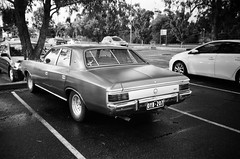 1981 Chrysler Regal rear (Matthew Paul Argall) Tags: kodakstar500af 35mmfilm blackandwhite blackandwhitefilm ilforddelta100 100isofilm car vehicle automobile transportation oldcar classiccar chrysler chryslervaliant chryslerregal carspotting