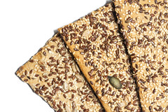 Flax and sunflower seeds healthy food over white background (wuestenigel) Tags: flax natural whole closeup linseed grain brown background healthy agriculture plant food macro ingredient organic pile flaxseed vegetarian black seed sunflower crop nutrition white desktop lebensmittel nahansicht refreshment erfrischung sweet süss chocolate schokolade isolate isolieren diet diät texture textur pattern muster noperson keineperson tasty lecker gesund breakfast frühstück disjunct disjunkt confection konfekt traditional traditionell gold candy süsigkeiten cereal müsli