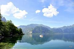 O silêncio!! (puri_) Tags: lago água azul verde margem árvores montes céu núvens brancas barco reflexos
