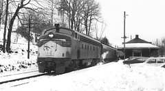 New Haven Railroad EMD FL-9 locomotive # 2019, is seen in the snow with a short Northbound train # 140, while it is stopped at the station in Branchville, Connecticut, March 24, 1967 (alcomike43) Tags: newhavenrailroad branchvilleconnecticut railroads trains passengertrains commutertrains snow winter coach station depot platform vehicles train140 emd fl9 newyorknewhavenhartfordrailroadcompany diesel engines locomotives dieselengine diesellocomotive dieselelectriclocomotive 2019 steam headlight photo photograph negative bw blackandwhite old historic vintage classic