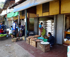 Selling rice and eggs (Claire Backhouse) Tags: rice eggs market markets selling buying vendor organic horticulture agriculture working shopping traditional everydaylife life street streetphotography streetscene streetlife longyi burma burmese myanmar nyaungu manisithu