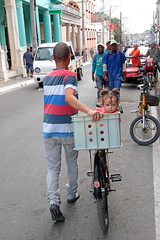 The Kid In The Crate (peterkelly) Tags: digital canon 6d northamerica cuba cubalibre gadventures pinardelrio crate street road bike bicycle baby child girl