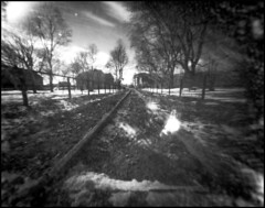 0095 2019 Tmax100 (old) (rubbernglue) Tags: pinhole 4x5 flare traintracks uppsala 2019 bw blackandwhite bwfp filmphotography filmexif analog analogexif analogwithexif 50mm hc110 redfilter fph45 sweden sverige