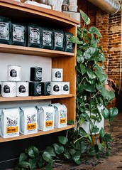 black and white plastic packs on shelf - Credit to https://myfriendscoffee.com/ (John Beans) Tags: coffee plant cafe coffeebean coffeebeans shopbeans espresso coffeecup cup drink