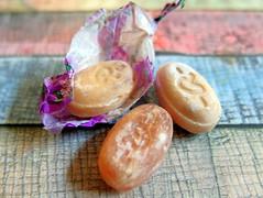 Damaged candy for Macro Monday (Zandgaby) Tags: candy damagedcandy macromonday orange fadedcolours oldcandy wrapping lightblue fujifilm x20 fuji fujifilmx20
