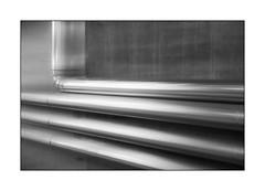 RichtungsWechsel (Panasonikon) Tags: panasonikon sonyrx100m4 bw sw linien lines pipes rohr bewegungsunschärfe grafik grau grey explore