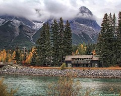 The Bow River in Canmore, Alberta Canada (PhotosToArtByMike) Tags: canmore albertacanada alberta bowvalley canadiancity southerncanadianrockymountains residential town city rockymountains provinceofalberta bowriver vacationhouses residences