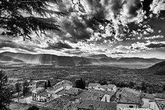 Valle Peligna from Pacentro, Abruzzo, Central Italy (Claudio_R_1973) Tags: black white blackandwhite pacentro vallepeligna abruzzo centralitaly valley apennines mountains rays beams sunset afternoon clouds cloudy landscape village architecture italian italy monochrome dramatic outdoor