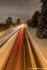 Snowy road with light trails (james c. (vancouver bc)) Tags: night track yellow orange red white highrise apartment colour colorful color snowy road vehicle light trail icy sky car tree cold snow canada winter longexposure traffic wintertime outdoors vancouver newwestminster bc britishcolumbia lane speed motion highway darkness exposure abstract headlight logistics taillights curve lines