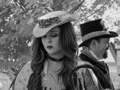 Thoughts of the Day (clarkcg photography) Tags: woman dulce hat hair thoughts ready renaissance faire festival blackandwhite blackwhite bw candid street streetphotography