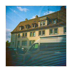 hurting slices - reflected analog Holga window world (Armin Fuchs) Tags: arminfuchs holga analog film mittelformat mediumformat 120mm kodak 6x6 würzburg window reflection stripes anonymousvisitor sky blue house car square windows ektar bus
