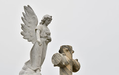 NOLA Greenwood Cemetery (dr_marvel) Tags: feathers wings nola neworleans cemetery angel louisiana cross graves tombs heaven sky greenwood statuary statue