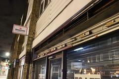 Night Shoot, 95 (doojohn701) Tags: shop front buildings shops white postmodernist architecture flourescent tubes t12 reflection glass windows dusk dark night shutter sky village uk