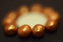 Bronze pearls... (Maria Godfrida) Tags: pearls bronze round balls chocolate macro closeup bokeh light object smileonsaturday shadesofbrown