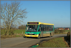 Hens Tooth Express (Jason 87030) Tags: willoughby sawbridge warks warwickshire hedge tree holly bare naked branches light feb february 2019 green yellow optare solo lady driver 203 princethorpe grandborough countylinks flexibus puddle reflection hedgerow outside outdoors clayton jasmine bus transport wheels sunny bluesky service route yj58cfe amgroup
